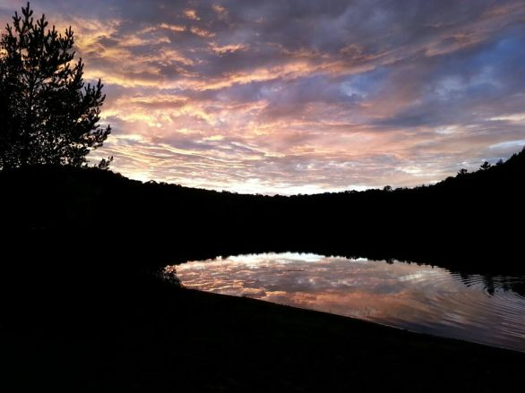 A painted sky surrounds the mountains around Oxbow Lake, NY. This is the view from our cabin door. It doesn't get any better than this...